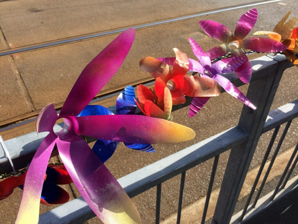 Recycled plastic flowers garlanding the tramway in Cleveleys
