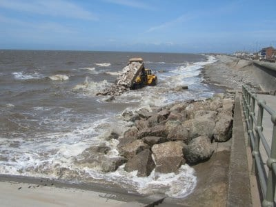 Creating a stockpile at high tide of groyne foundation stones