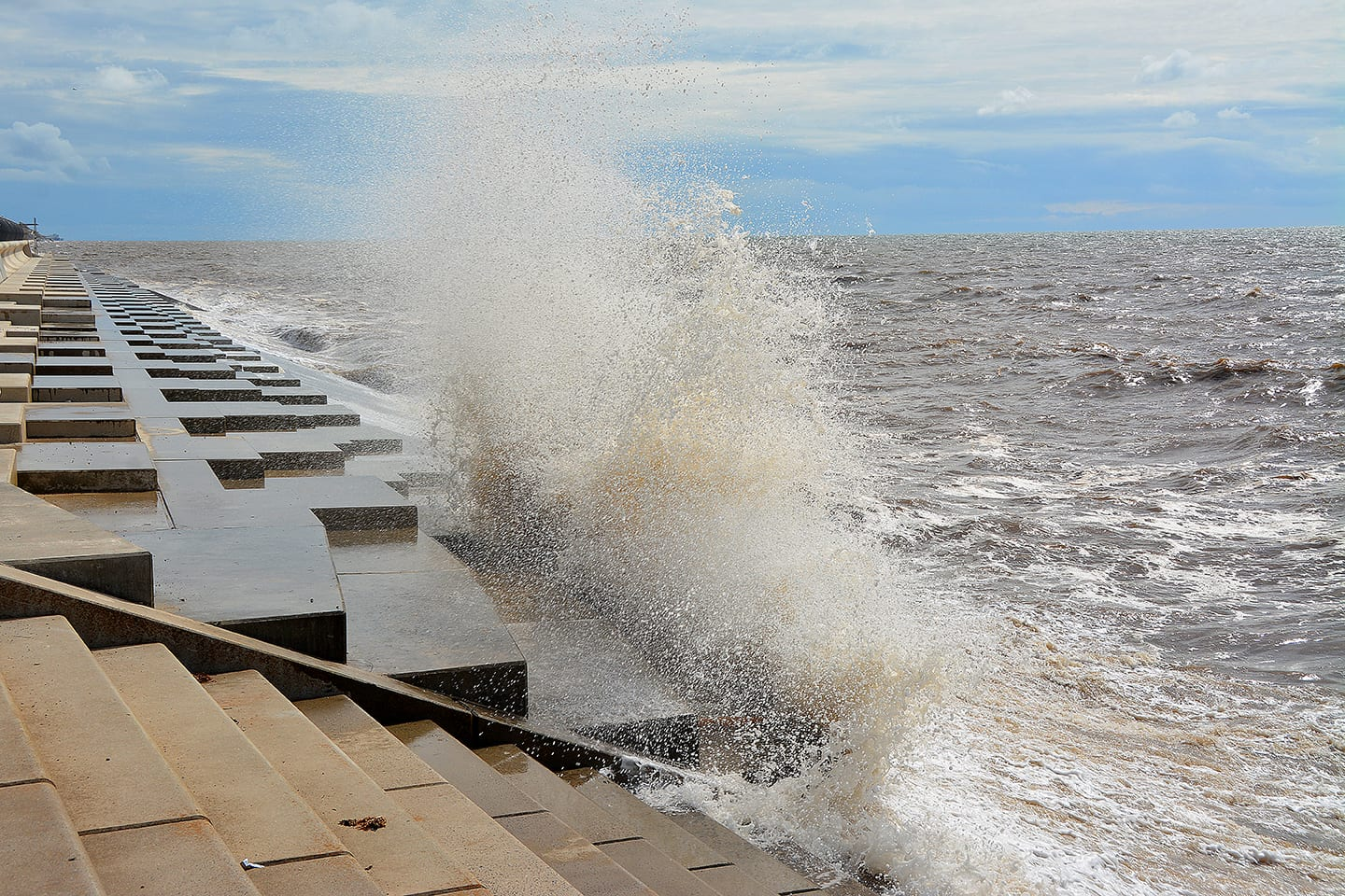 Spanish steps at Cleveleys seafront meet the sloping revetment and wave breaker units at Anchorsholme, Blackpool