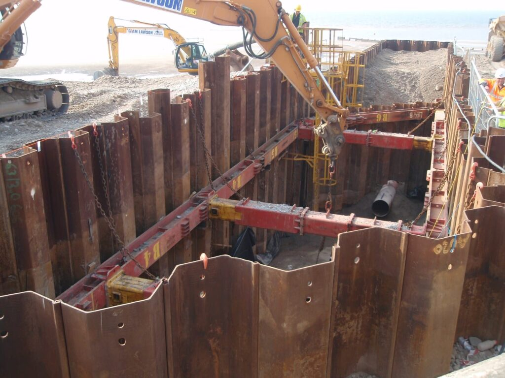 Steel pipe being installed in the cofferdam