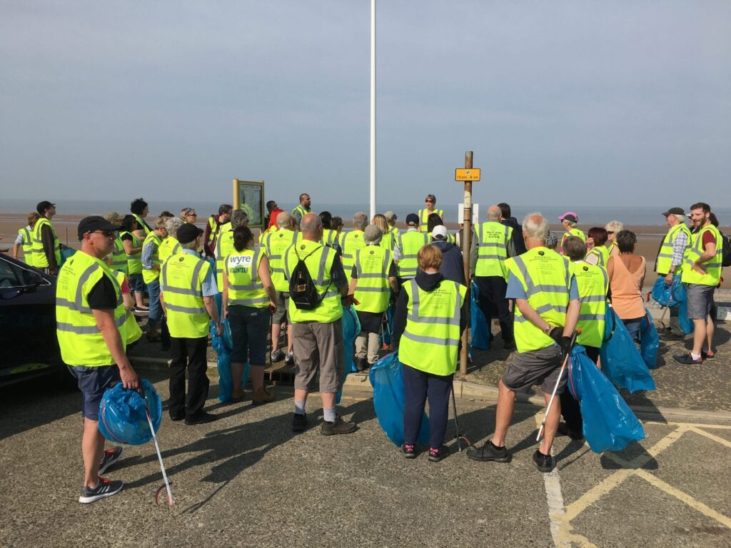 Meet for a briefing before community beach cleaning