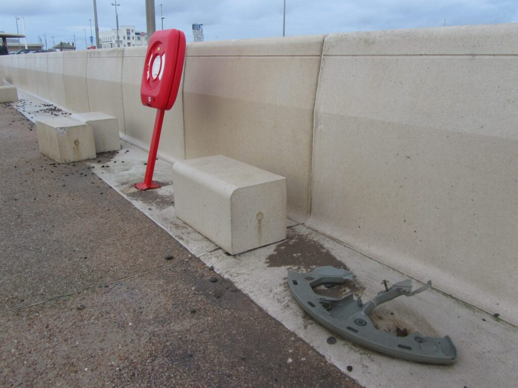 Litter bin wrenched from the floor, concrete blocks moved and the lifebelt housing bent out of shape, caused by Storms, Sea Coming Over and Flooding