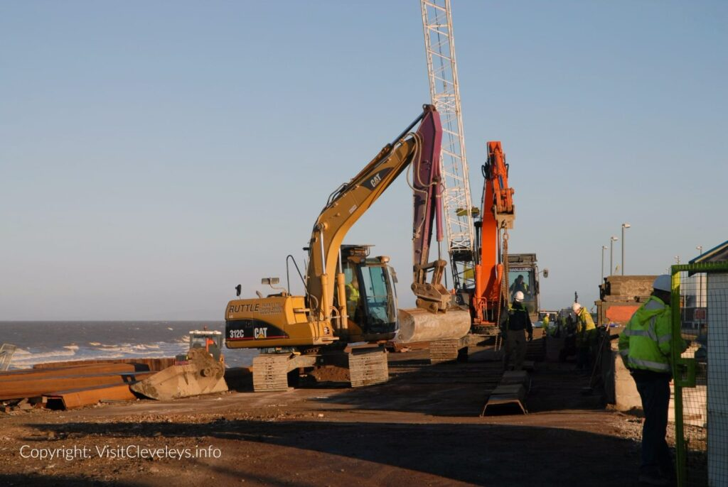 Steel piles and heavy machinery on site during Cleveleys sea wall build 2007
