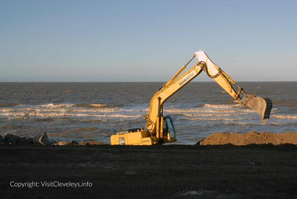 Diggers on Cleveleys beach during the sea wall build 2007