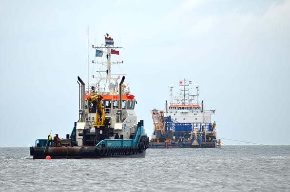 The Stemat Spirit cable barge at anchor offshore, the day before the cable pull operation