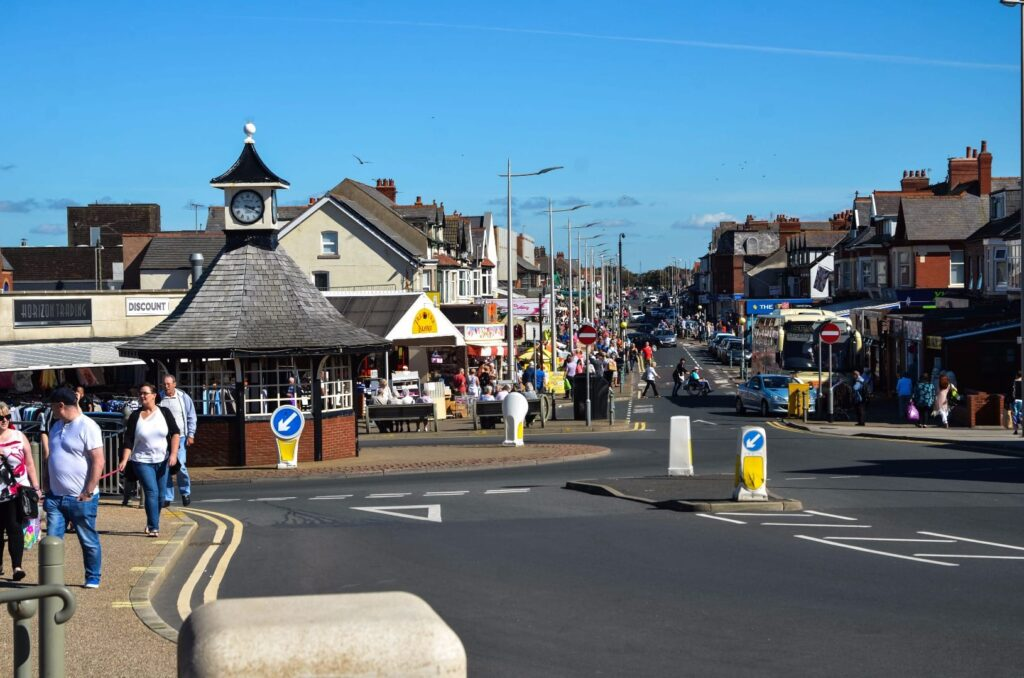 Shopping in Cleveleys Town Centre, looking along Victoria Road West from the seafront