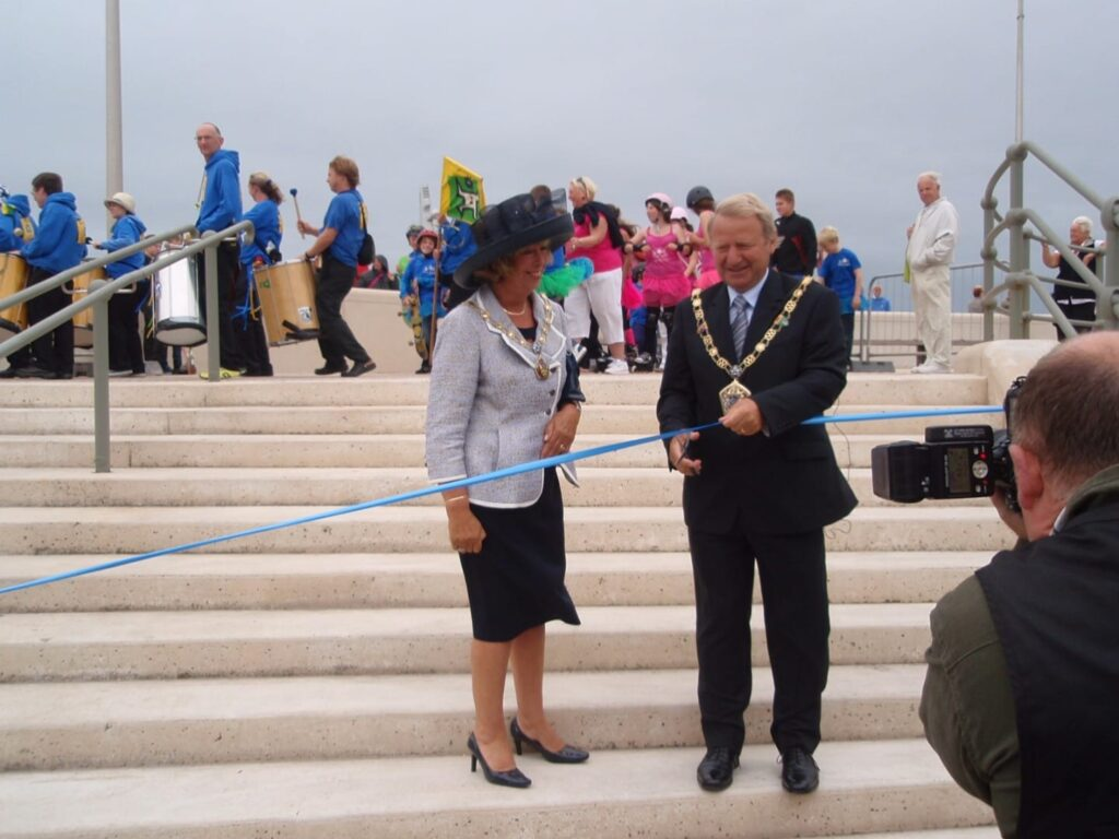Cllr Russell Forsyth opening the sea defences and stepped promenade in July 2010