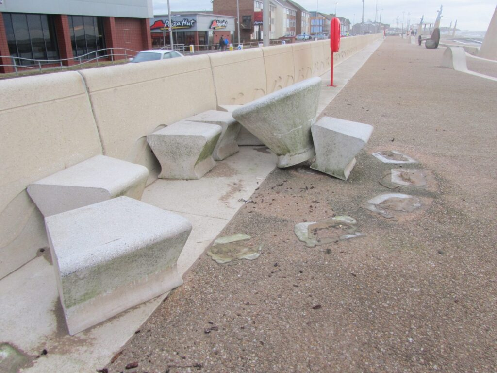 Another set of heavy concrete picnic tables picked up and thrown along the prom, caused by storms, sea coming over and flooding