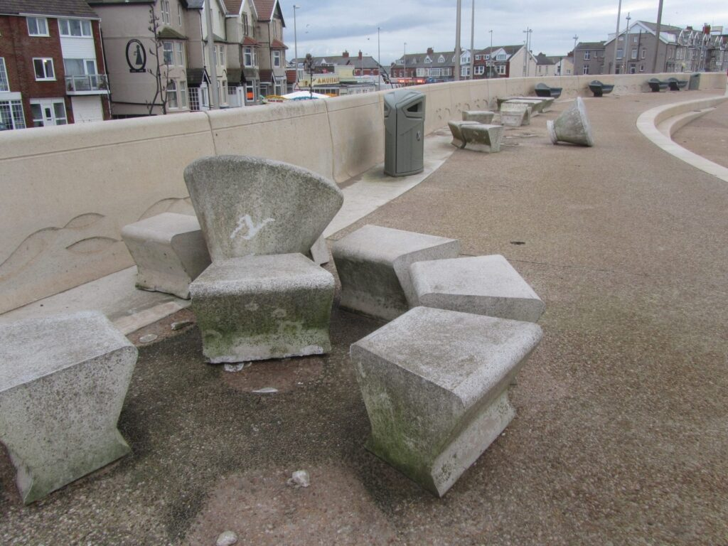 And yet another set of heavy concrete picnic tables picked up and thrown along the prom, caused by storms, sea coming over and flooding