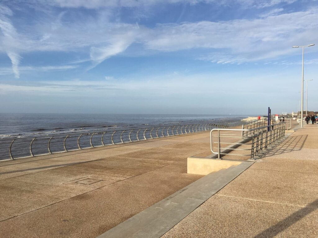 Wide walkways and a step to sit on at Princes Way Promenade