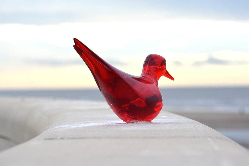 The red glass-look resin Sea Swallow - how it should have looked on the sea wall.