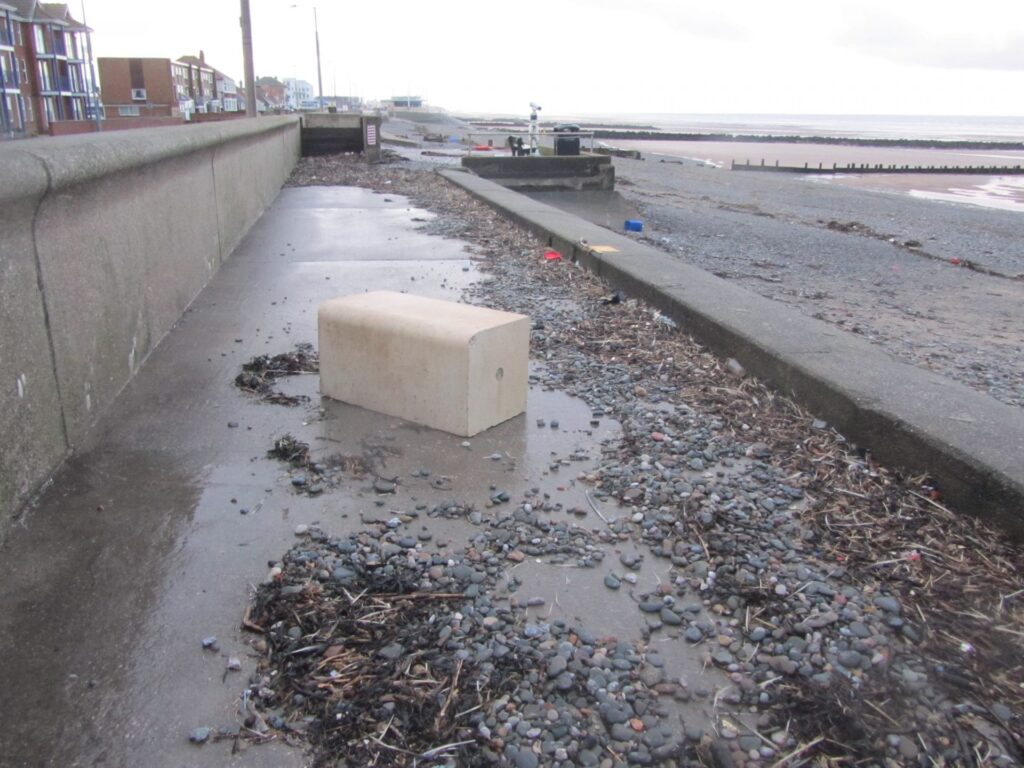 Some of the debris left behind on the promenade footpath at Rossall Beach after the storm of December 2013