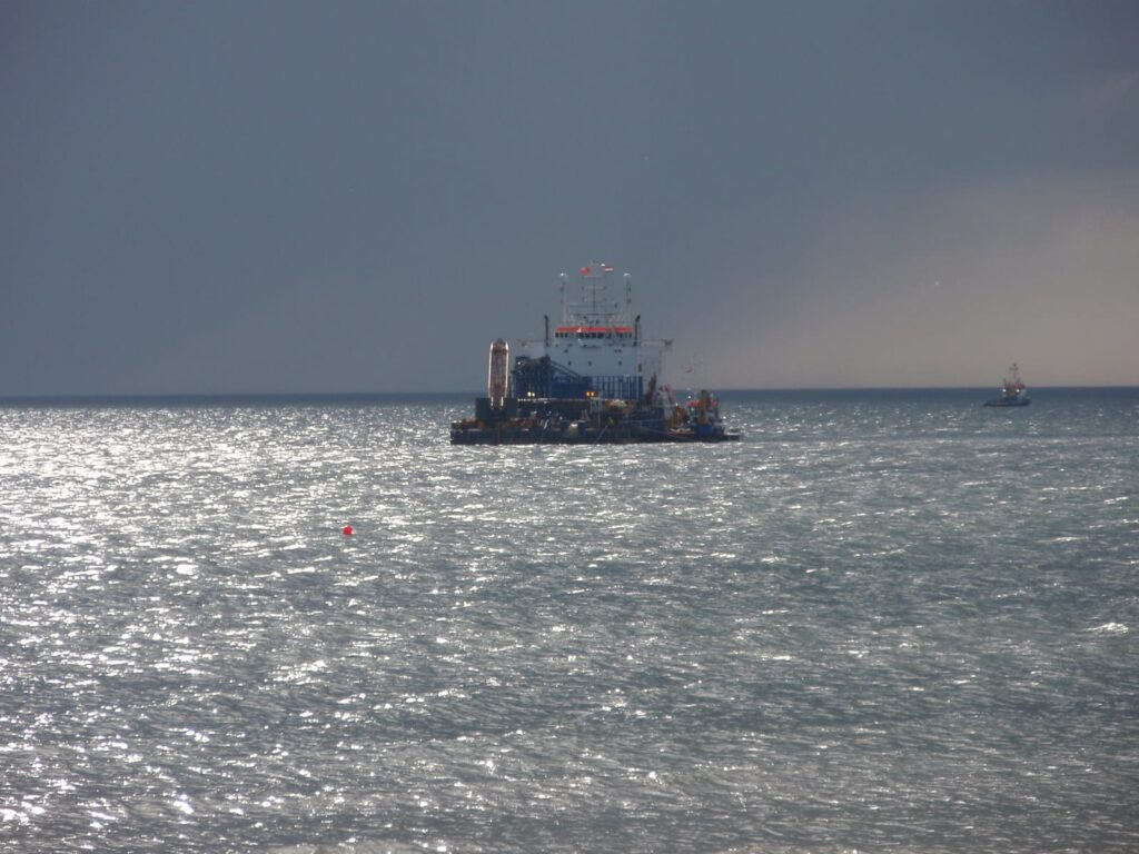 Stemat Spirit cable laying barge sailing away at the end of the day