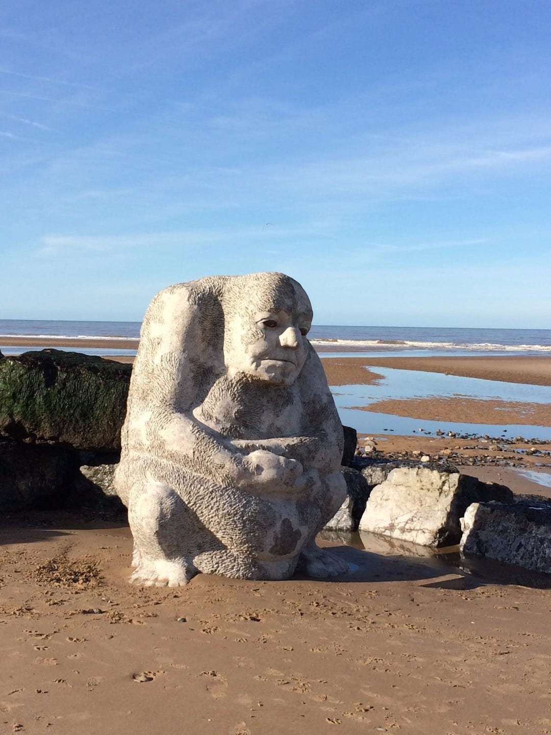 Stone ogre on Cleveleys beach, part of Sea Swallow artwork trail
