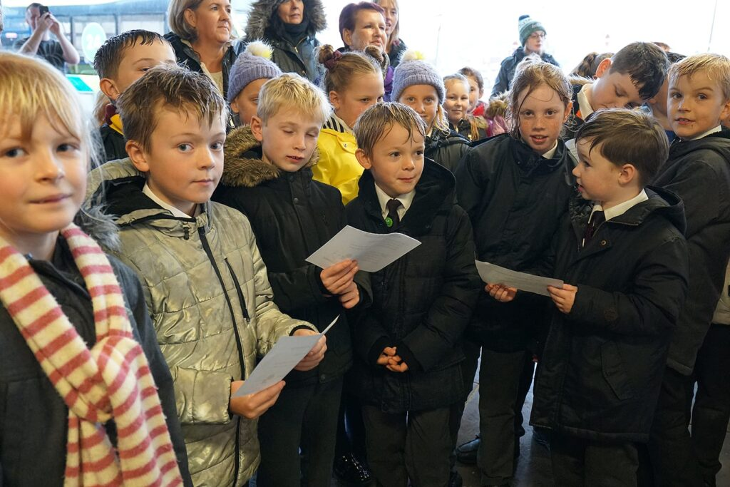 Children from Northfold School singing. Cleveleys Coastal Community Team updates.