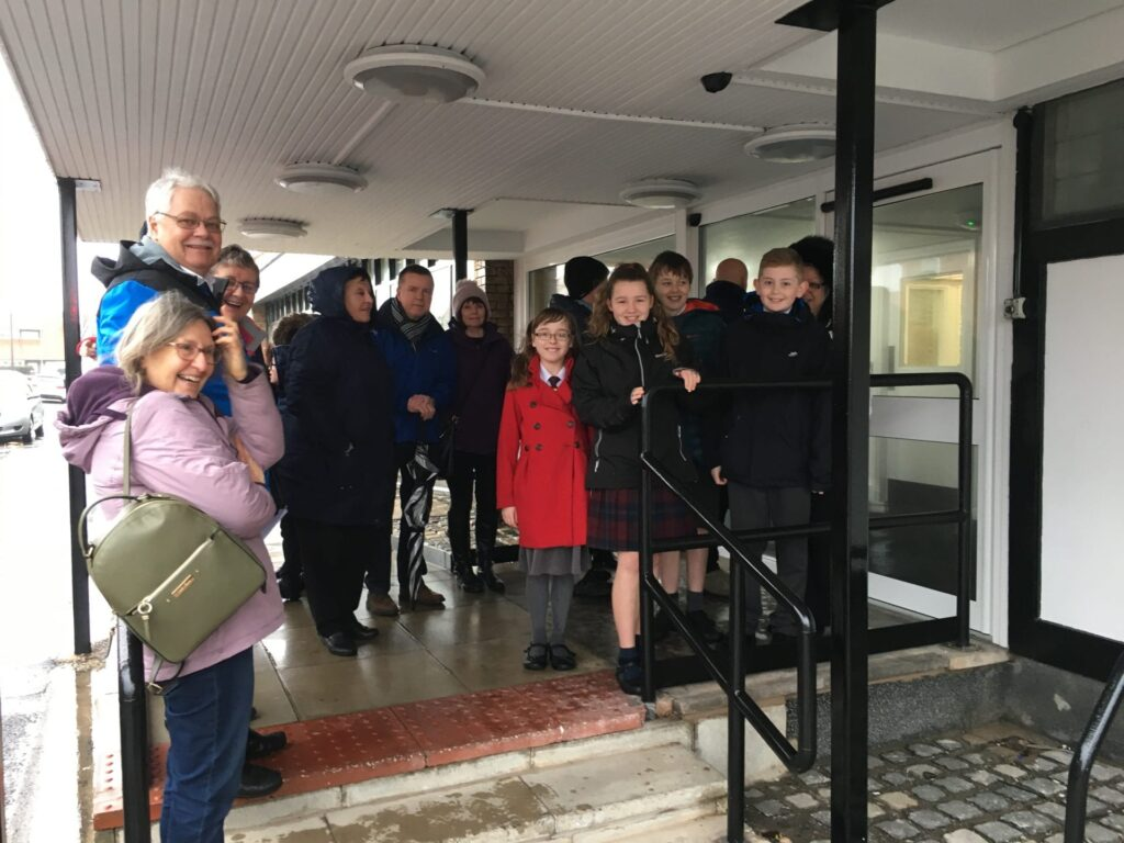 Gathering in the rain for the official reopening of Cleveleys library