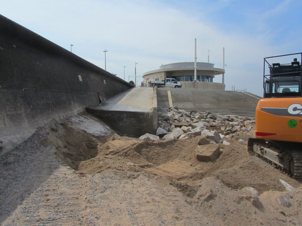 The previous sharp end to the concrete beach access ramp, and the low beach level in June 2013