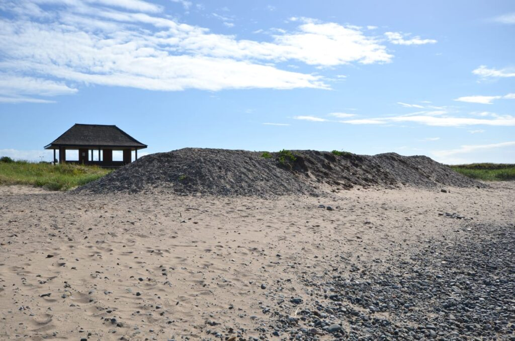 Sand and shingle stored at the back of the boating lake at Fleetwood, July 2013